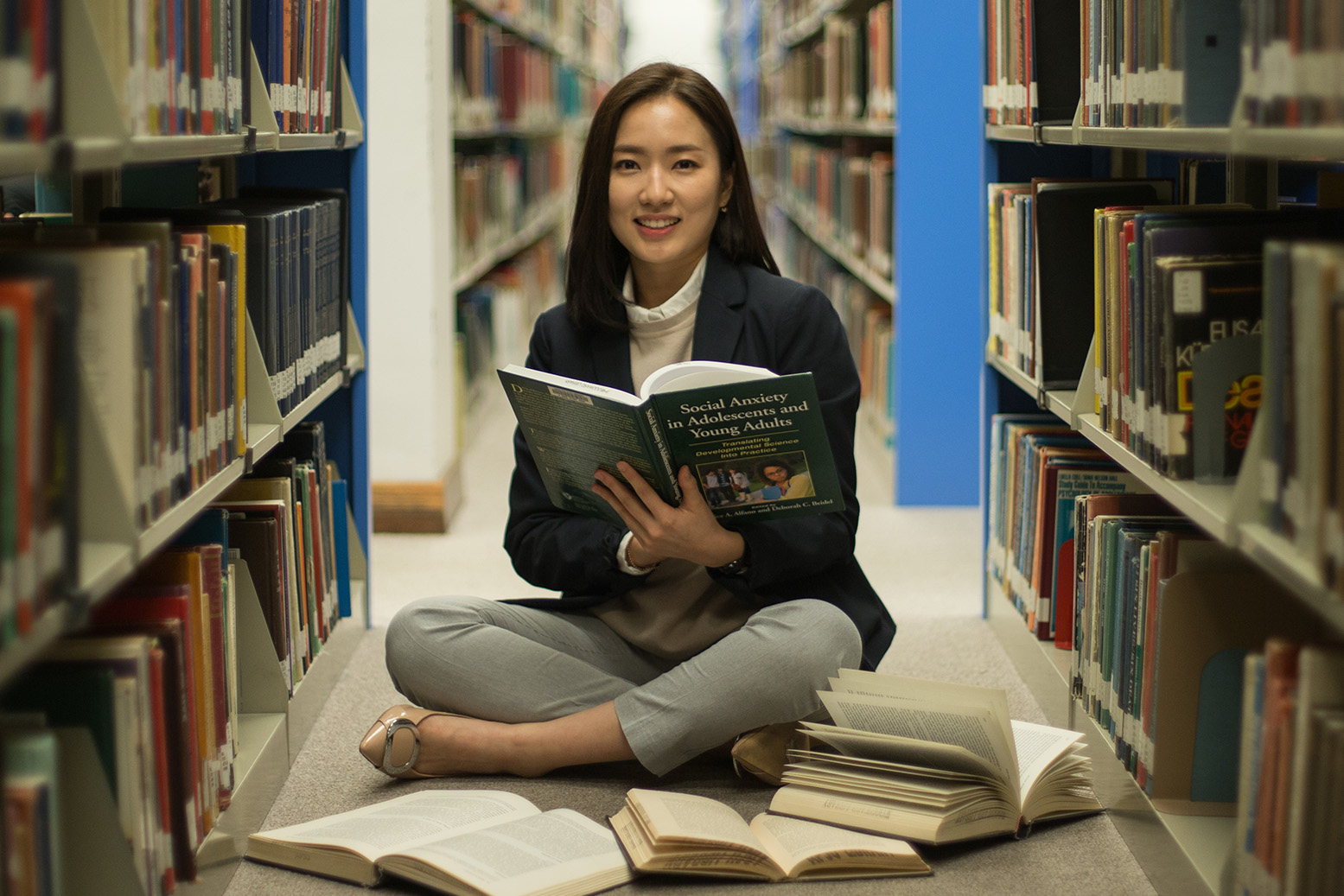 Psychology student sits in library