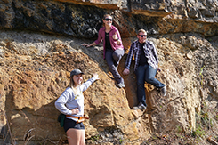 Students examine rock wall during alternative break trip