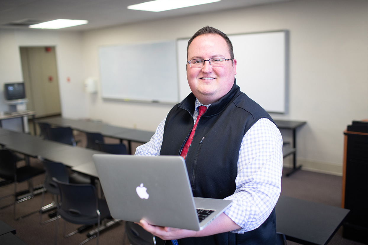 education doctoral candidate poses in classroom