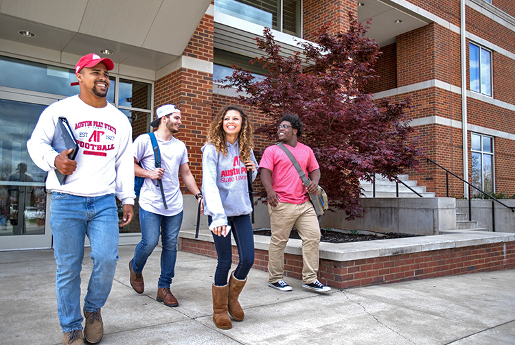 Students pose in housing quad