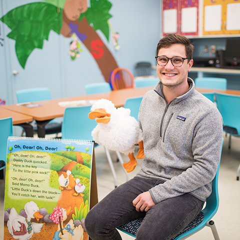 Kyle Thompson sits in classroom