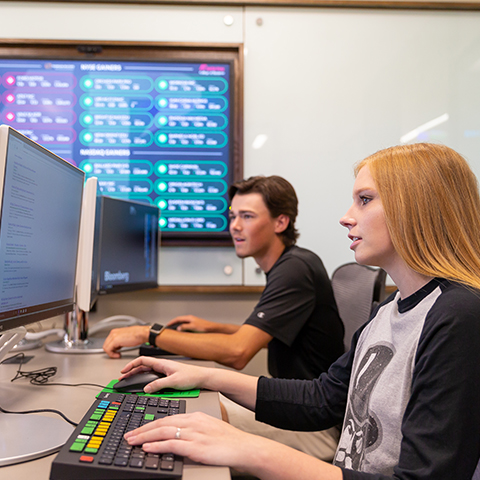 Business students work in trading room